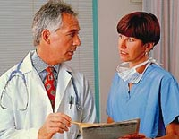 Picture of a doctor and nurse reviewing a patient's chart